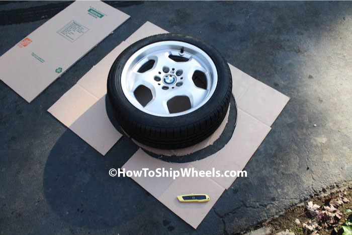 open up box after cutting in half, lay wheel on top, cut excess material away