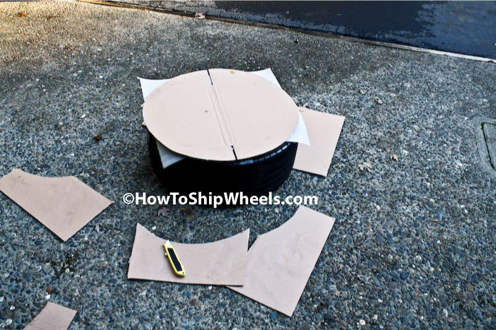 secure cardboard over dish wrap to face of wheel