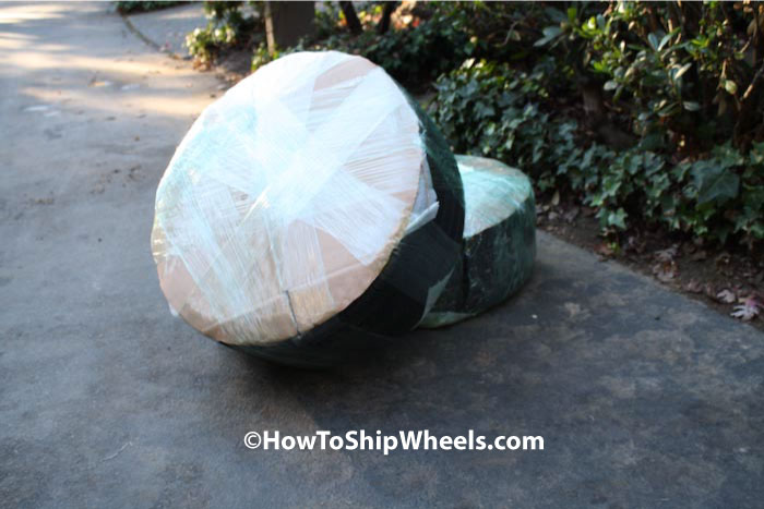 use packing wrap to wrap wheels and tires, the tighter the packing wrap the more secure